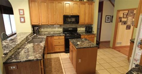 picture tiles for kitchens in this kitchen we updated the existing cabinets with 4195