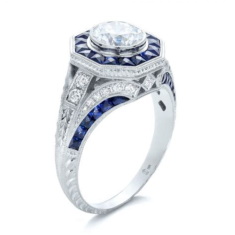 deco style blue sapphire halo and engagement ring
