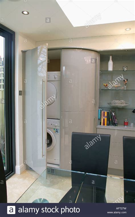 Tumble Dryer In Cupboard by Door Open On Washing Machine And Tumble Dryer Concealed In