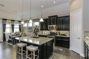 Gehan Homes Kitchen Black Cabinets Light Granite
