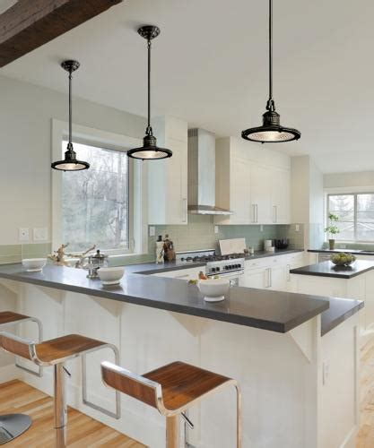 industrial pendant lights accent a transitional kitchen