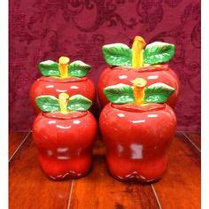 ceramics canisters and apples on