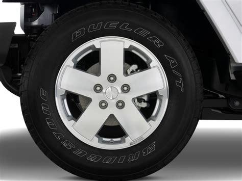 image  jeep wrangler wd  door sahara wheel cap