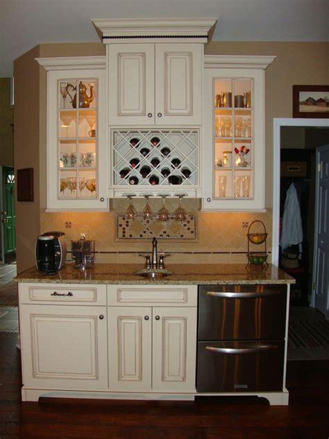 cute built  wine rack  glass light  cabinets