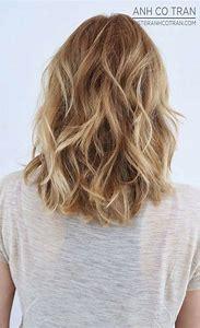 Medium Length Layered Hairstyles Wavy Hair