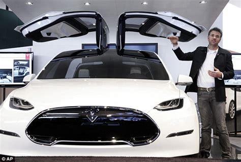 car door open up tesla launches its model x electric suv with falcon wing