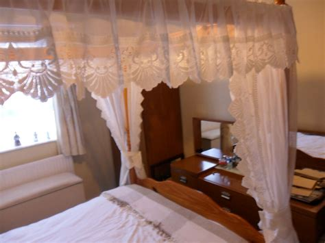 Four Poster Drapes - white or luxury lace trimmed four poster drapes and