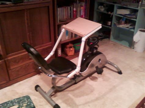 exercise bike with desk white cabinet doors kitchen