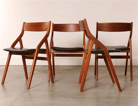 set of four dyrlund modern teak folding dining