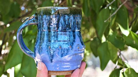 It does not contain lead or cadmium. Jerry Blue with Candy Apple Green Drip Mug - Rose LeVeque Pottery