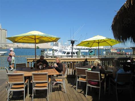 grills seafood deck tiki bar port canaveral view the cruise ships passing by from inside or the deck