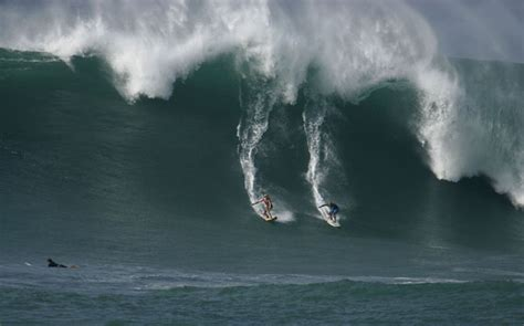 surfs  huge waves hit hawaii  news  guardian