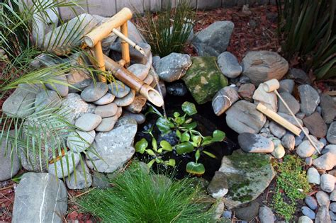Small Water Garden Designs With Bamboo Fountain And