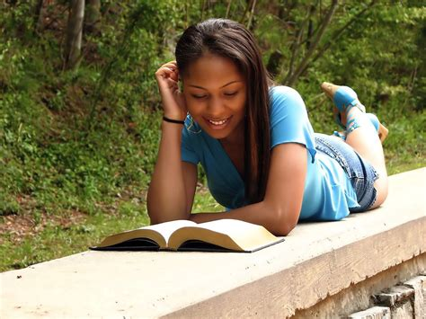 Reading Girl  Free Stock Photo  A Beautiful African American Teen Girl Reading A Book On A