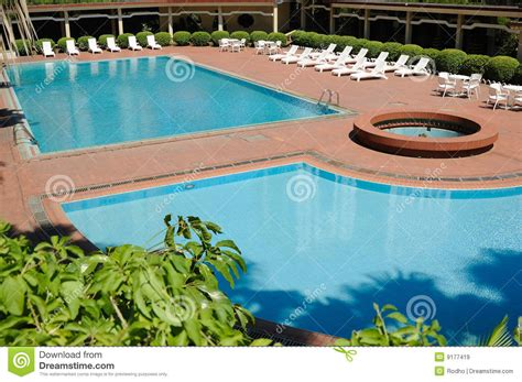 swimming pool and deck chairs royalty free stock images