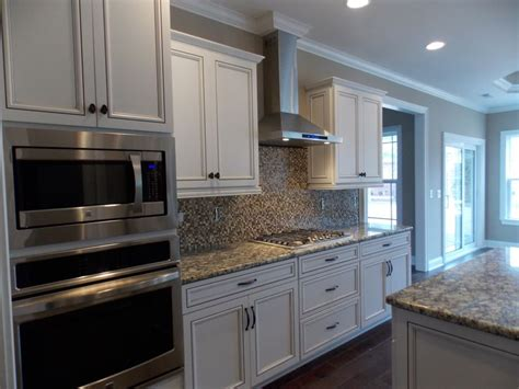 beautiful alabaster cabinets  chocolate glaze compliments  hardwood floors  appliances