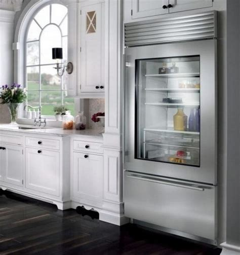 Classy White Kitchen Cabinets Also Arched Window And