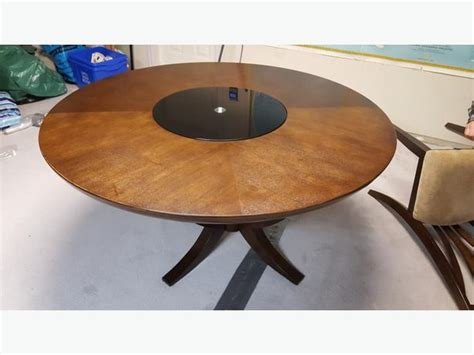 solid wood dining room table with glass lazy susan