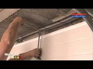 Poser une porte de garage motorisee gedimat ma maison for Ressort de traction porte de garage