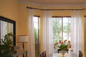 bow window curtain rods rooms