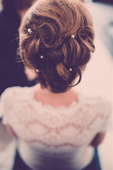 curled bridal updo  pearl hair pins