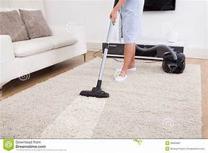 Maid Cleaning Carpet With Vacuum Cleaner Stock Photo ...