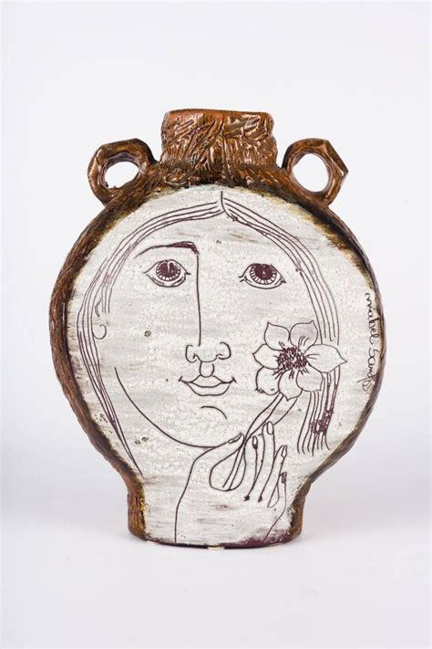 clay vessel  mabel santos white  brown  face