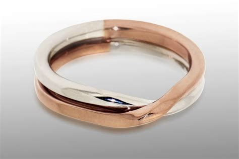 Love Knot Dual Metal Wedding Band. Lab Created White Sapphire Wedding Rings. Swirl Design Engagement Rings. Two Toned Wedding Wedding Rings. King Rings. Moissanite Engagement Rings. Personalised Wedding Rings. Kate Middleton's Engagement Rings. Twig Engagement Rings