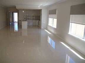 polished grey porcelain floor like the combo of this floor with the glossy white cabinets