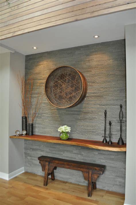 stone foyer wall  wood paneled ceiling hgtv