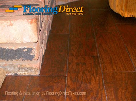 laminate flooring next to fireplace wood look tile in arlington by flooring direct flooring direct