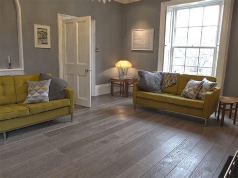 Laminate Flooring Living Room Design grey wood laminate flooring in living room with yellow