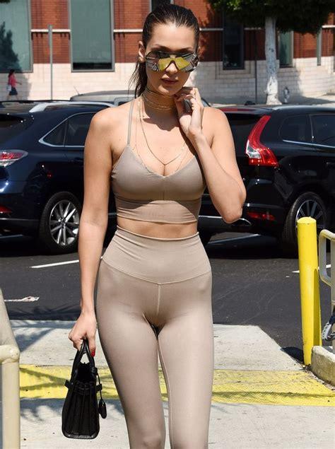 bella hadid wears a daring tight nude crop top and