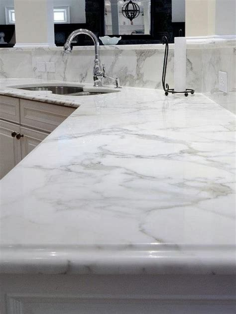 Calcutta quartz counter top   looking at this for the