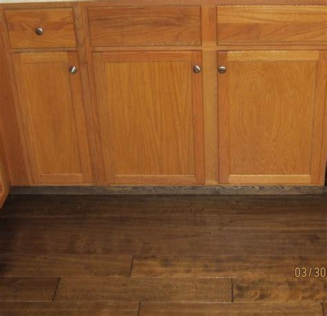 wood flooring with oak cabinets honey oak cabinets with dark wood floors wood floors