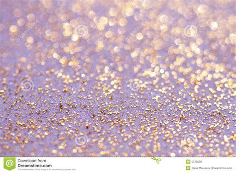 Golden Glitter Sparkles Dust Background Stock Photo