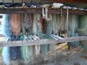 Beautiful hanging fishing nets in Yvoire | a.b. journey