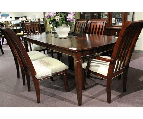 dark wood inlayed formal dining room table  leaf