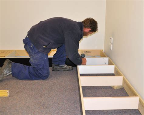 Installing cabinets on site, Installing modular units