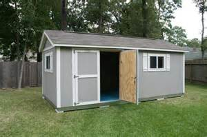 traditional backyard design with grey tuff shed design