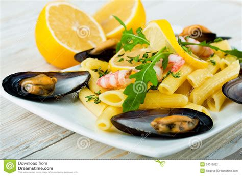 limoner cuisine pasta with mussels shrimp and lemon stock photography