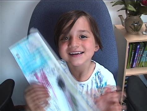 Stock Video Little Girl Shows Viewer Picture