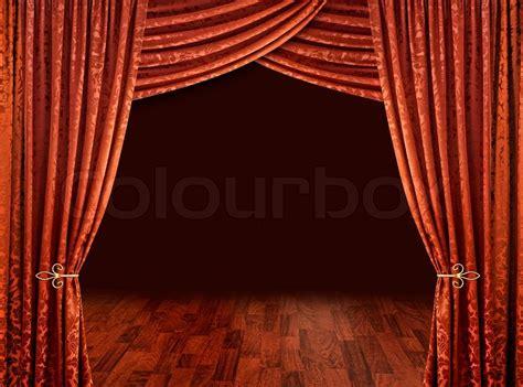 red theatre stage curtains brown wooden floor  dark