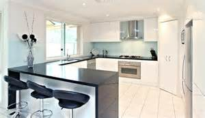 interior design of kitchen kitchen glossy white cabinets black quartz bench top