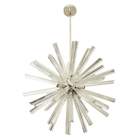 vintage starburst style chandelier in chrome and glass at