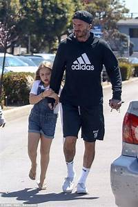 Harper Beckham holds on tight to her dad David on fun day ...
