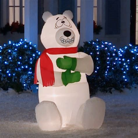 giant inflatable shivering polar bear  green head