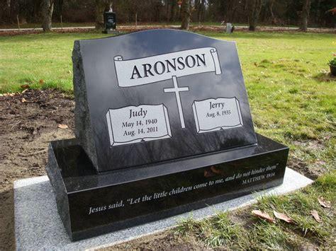 slant grave marker in absolute black granite set at