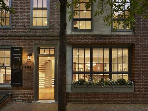 glorious window flower boxes with brick dark windows shutters