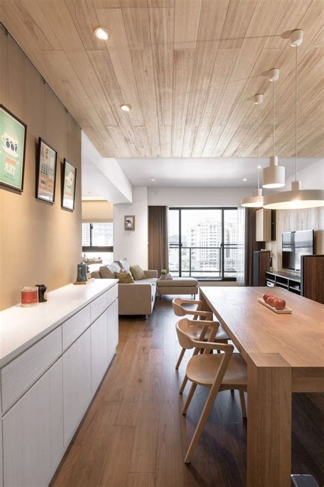 A Modern Apartment Celebrates The Look Of Wood by Apartment Wood Paneled Living Room Design Ideas